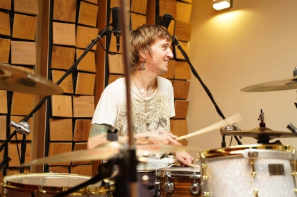 Drummer recording drums